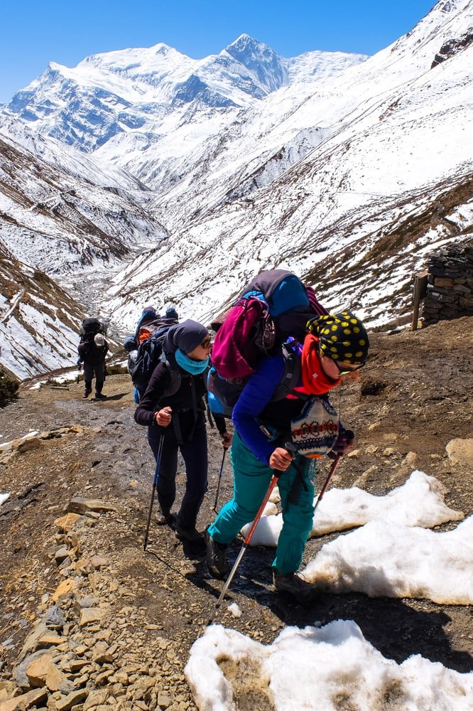 Girls hiking - Annapurna Circuit trek in Nepal, approaching Thorung Pedi