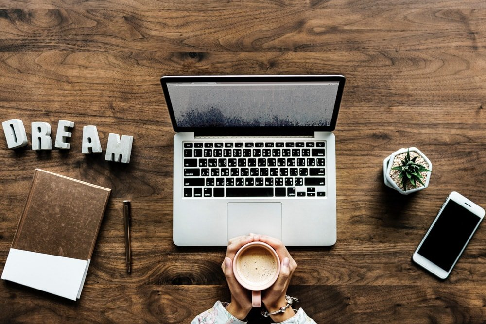 Laptop and phone on the table - Travel Resources