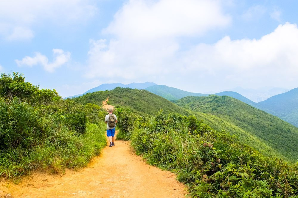 Man hiking the Dragon's Back Trail in Hong Kong