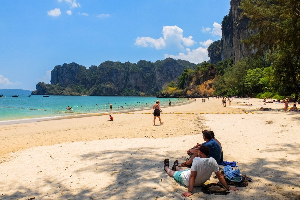 Men sitting on the beach in Thailand