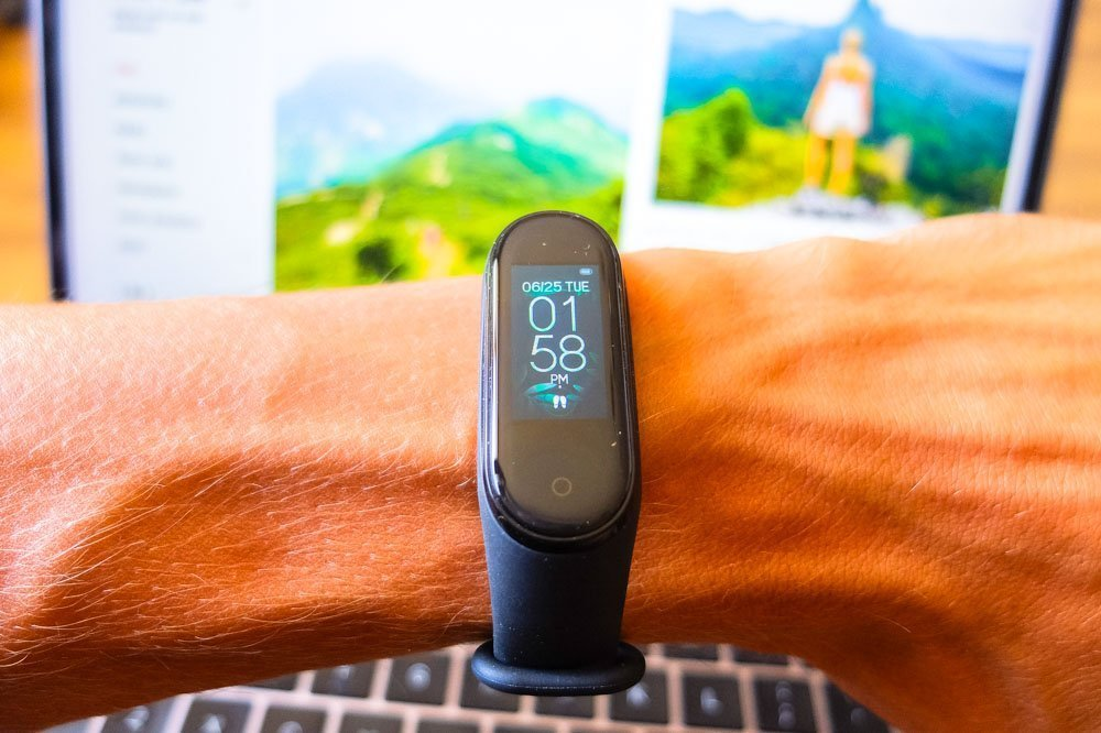 Xiaomi Mi Band 4 fitness tracker on my hand