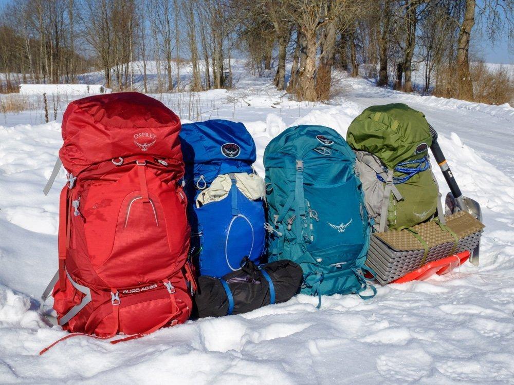 4 Osprey backpacks on the snow