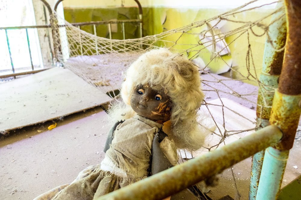 A creepy looking doll in kindergarten, in Chernobyl