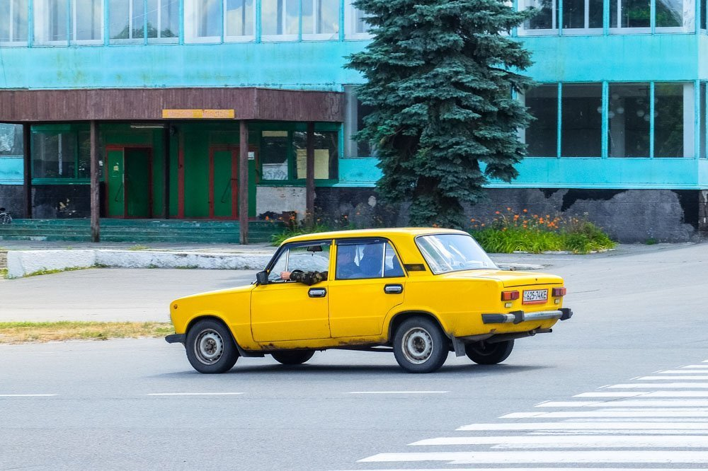 A yellow car in Chernobyl