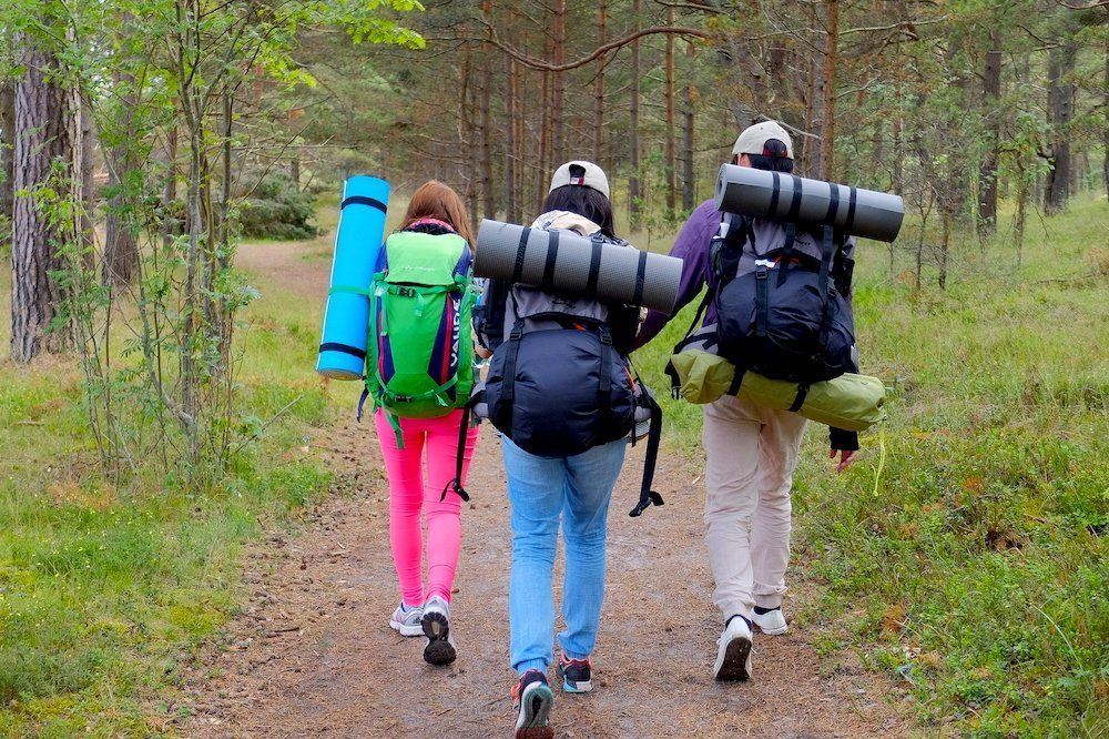 Three people hiking in Latvia