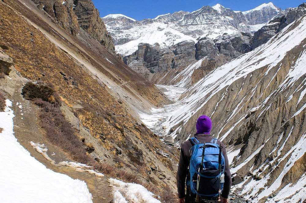 Hiking in Himalayas, wearing Osprey Farpoint 40 backpack