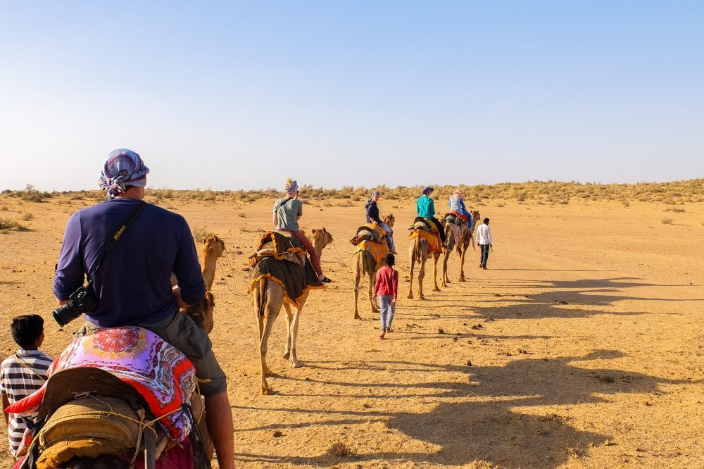 People riding camels in Jaisalmer India