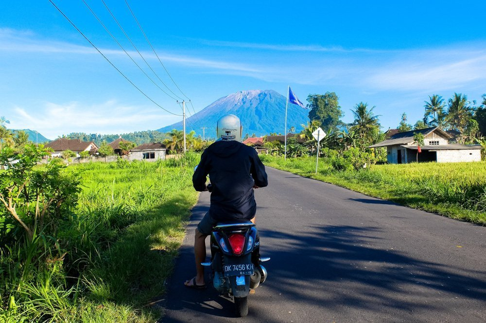 Riding a scooter in Bali, near Agung