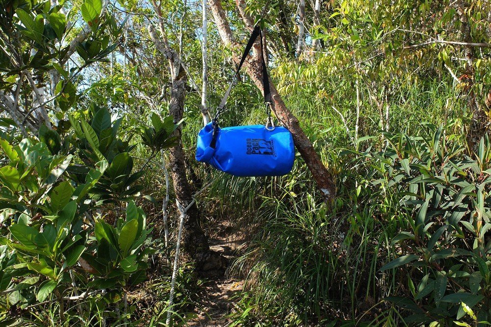 A dry bag hanging on a tree