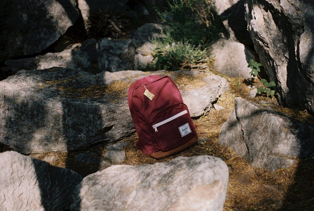 Small red backpack on the rocks