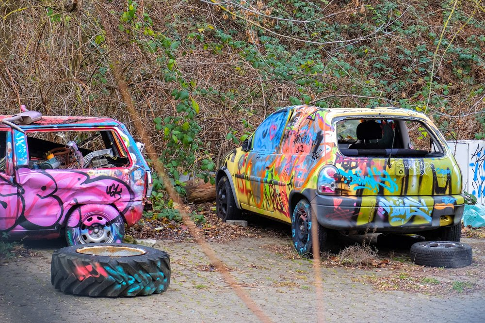 Colorfully painted cars at Teufelsberg