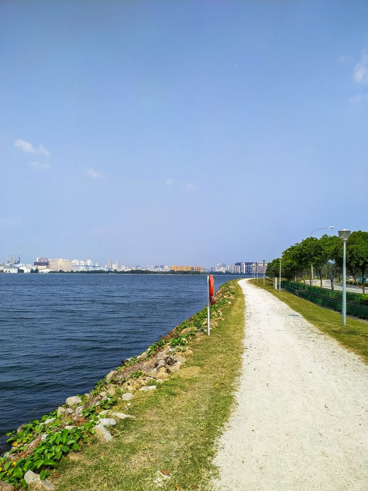 Cycling along a water reservour in Singapore