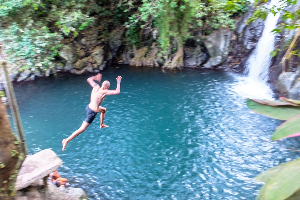 Jumping in waterfall in Bali