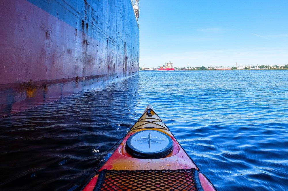Kayak next to a big ship