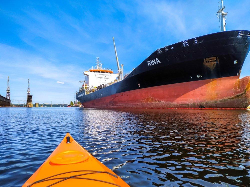 Kayaking next to a big ship