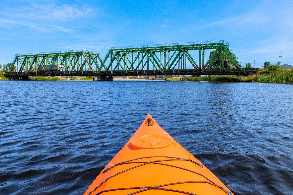 Kayaking next to railway bridge