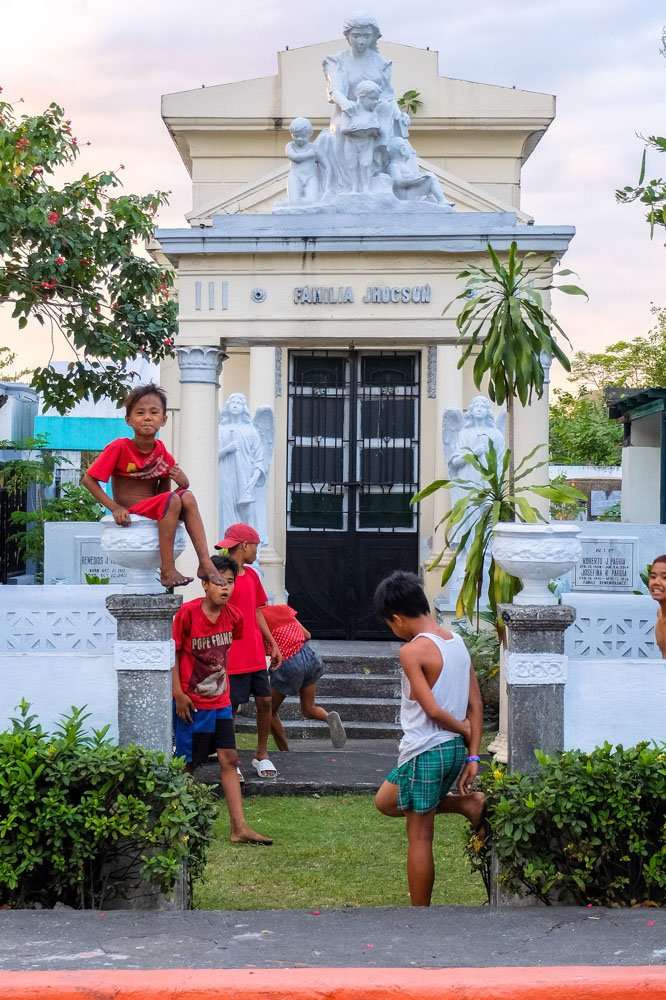 Kids in cemetery in Manila