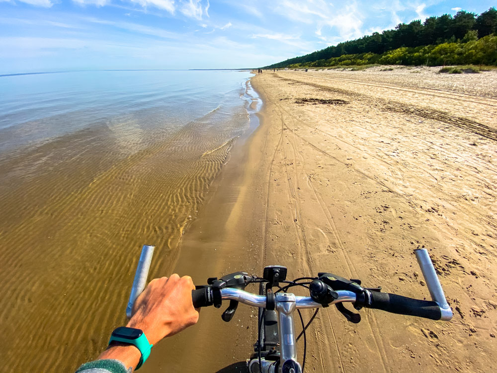 Cycling on the beach in Latvia