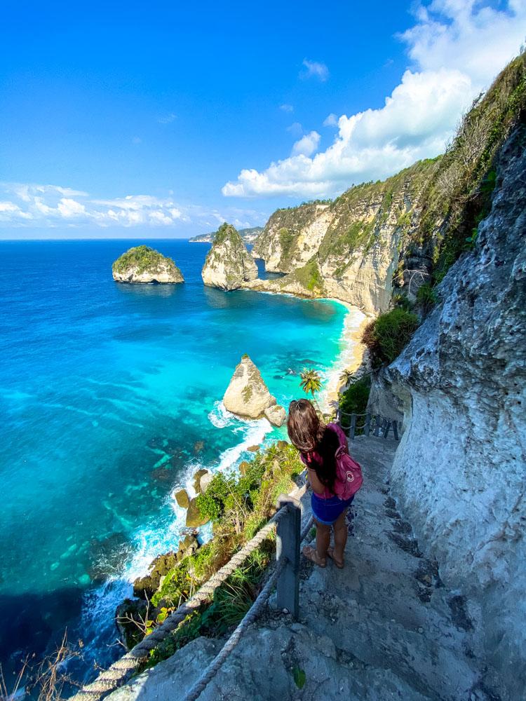 Girl going down to Diamond beach, Nusa Penida