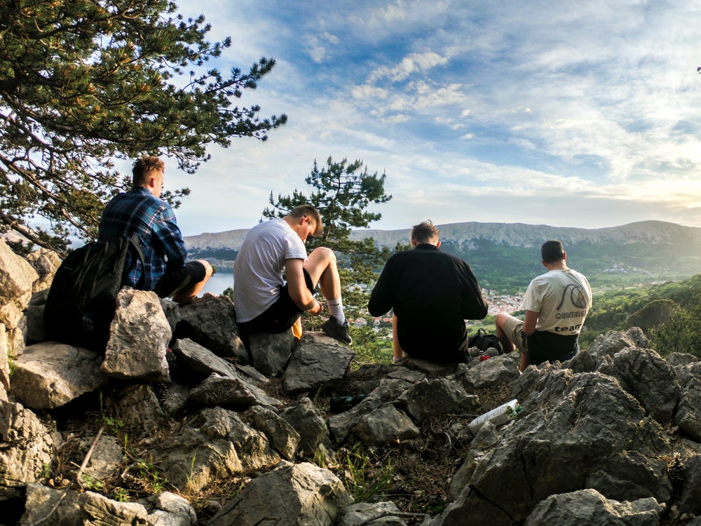 Men resting during a hike