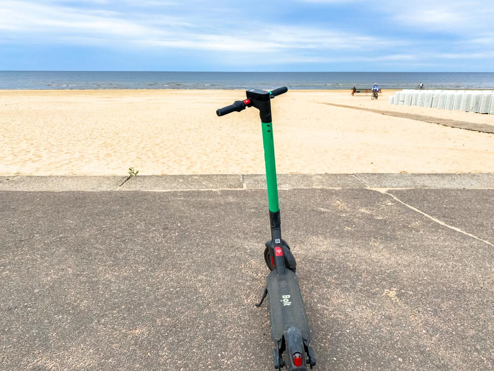 An electric scooter by the beach in Latvia