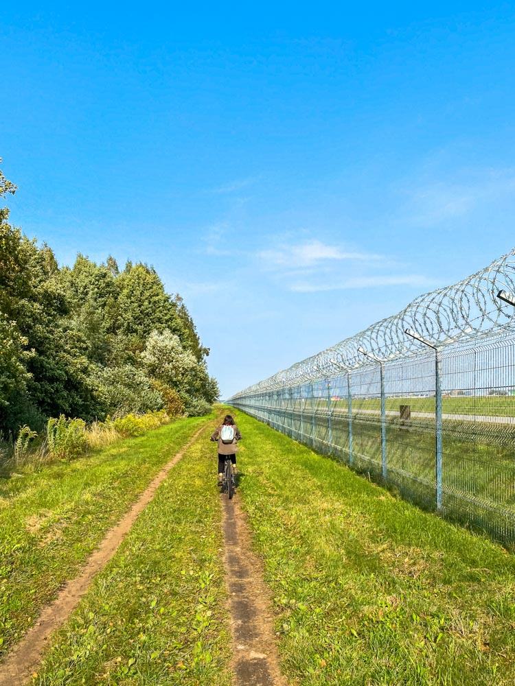 Cycling next to Riga airport fence