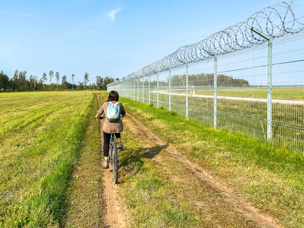 Cycling next to airport fence in Riga