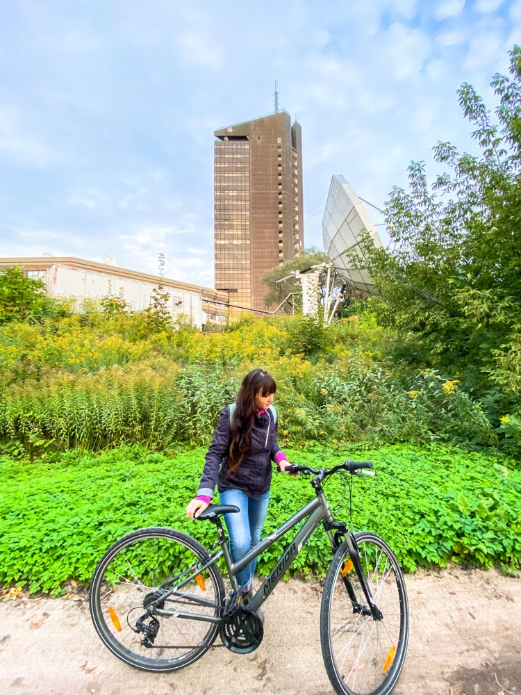 Cyclist and a tall building in the distance