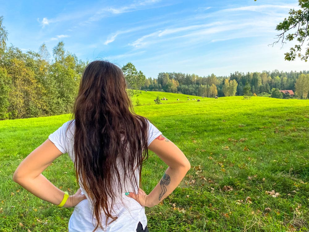 Girl and green fields in Latvia