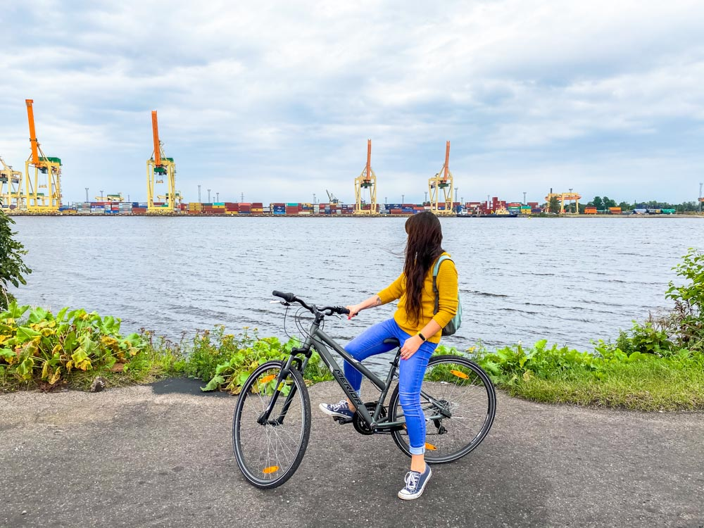 Girl on a bicycle near a port in Riga