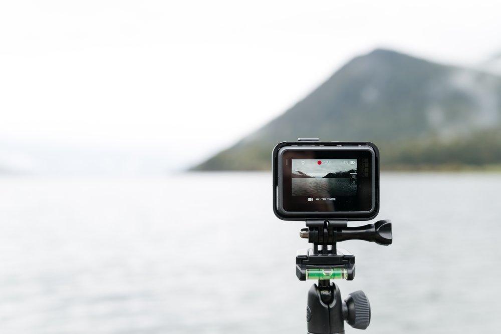 A black action camera