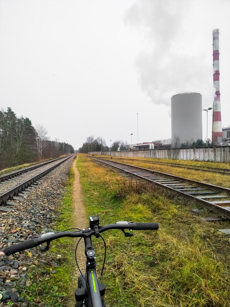 Bicycle standing next to rails