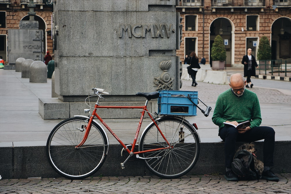 A man with a dog and bike