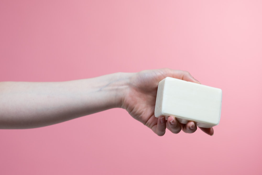 A person holding a soap bar