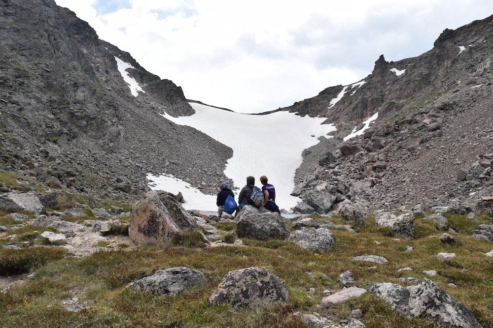 People looking at a glacier