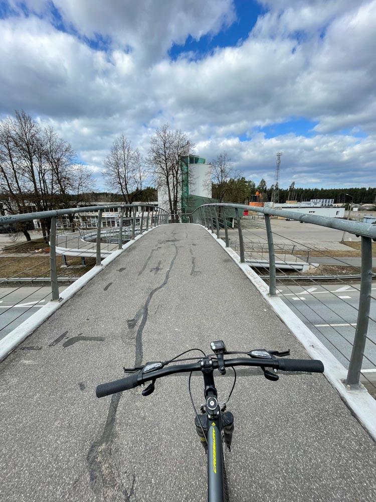 Cycling on pedestrian bridge in Bergi