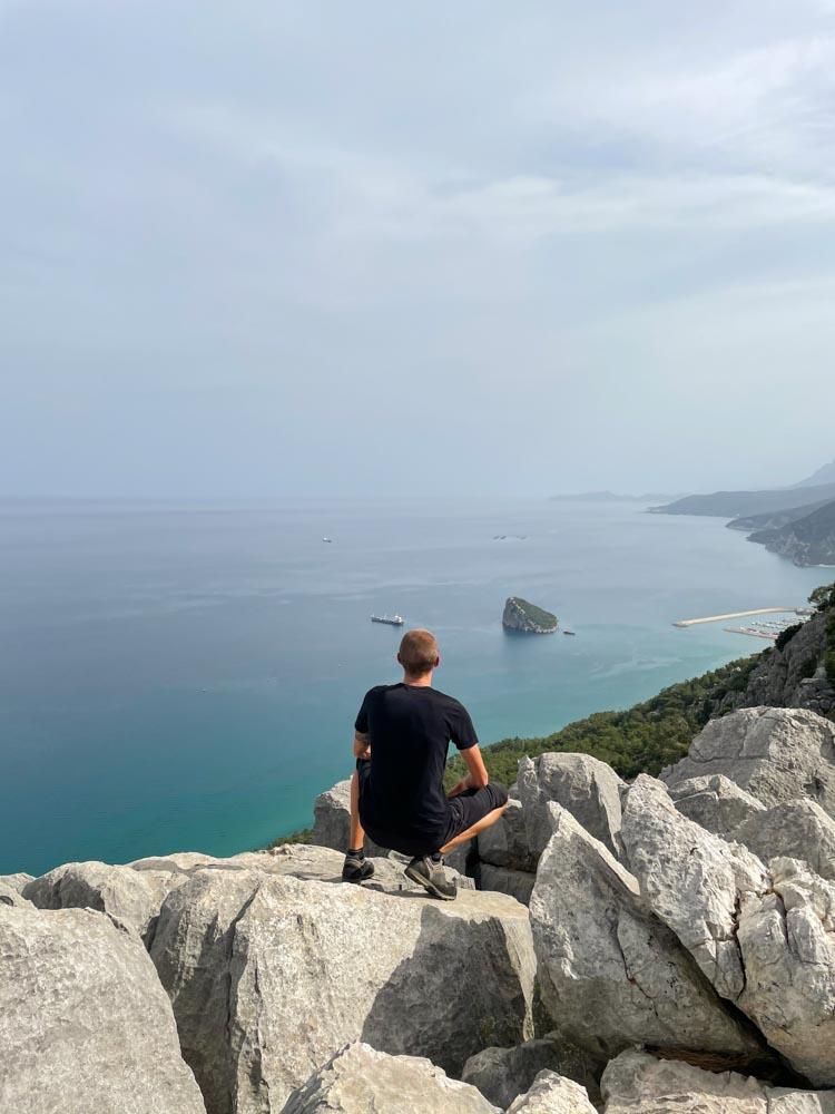 Kaspars sitting on a rock