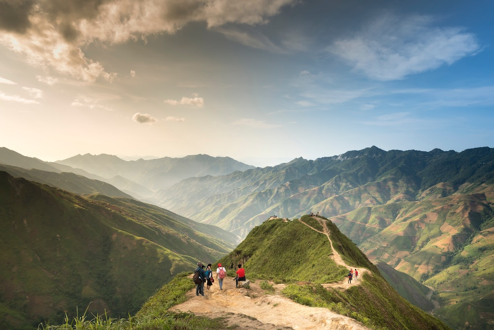 A group of people hiking in the mountains in Asia