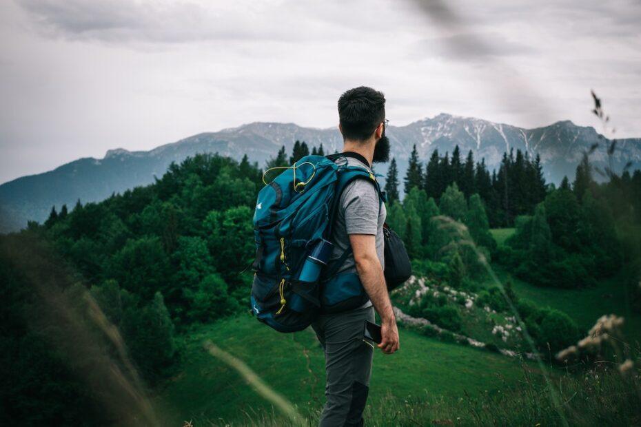 A man hiking in lush mountains