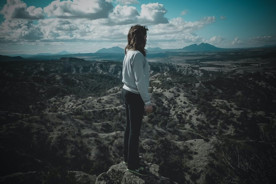 A young woman hiking in the mountains