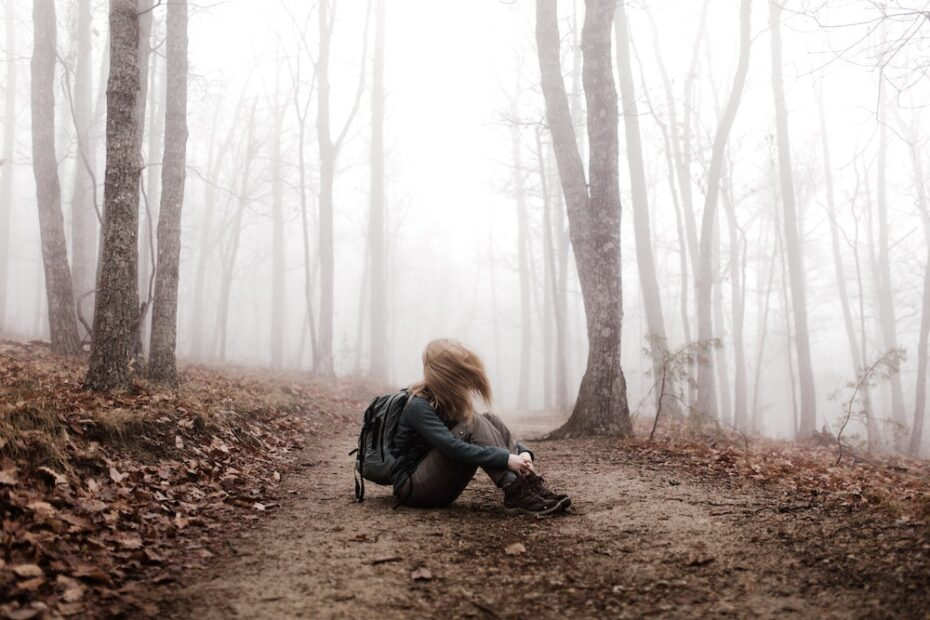 Woman hiking in the mist